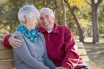 Senior couple sitting on park bench