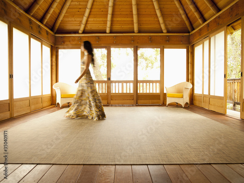 Asian woman walking in empty retreat