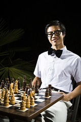 Mixed race geek playing chess