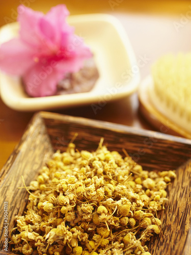 Close up of chamomile in wooden bowl