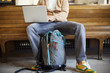 Caucasian man sitting on bench using laptop