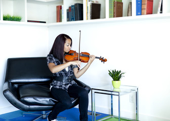Mixed race girl practicing violin