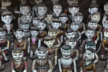 Rows of Vietnamese puppet figures