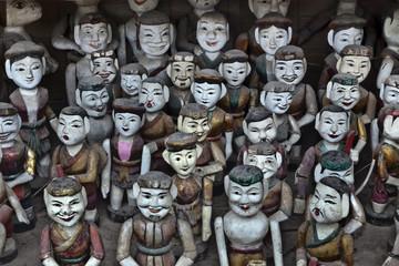 Rows of Vietnamese puppet figures