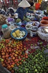 Vietnamese woman selling vegetables