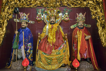 Ornate statues in Vietnamese temple