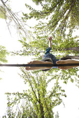Caucasian man balancing on rope in park