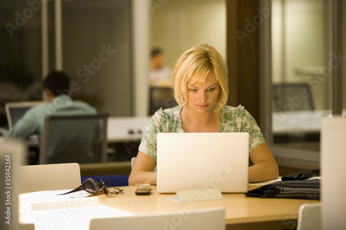 Caucasian woman using laptop in office