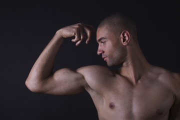 Mixed race man flexing biceps