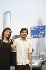 Chinese couple walking in urban area