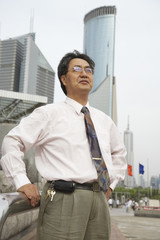 Chinese businessman standing outdoors