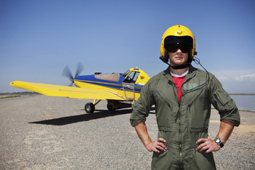 Pilot standing near small airplane