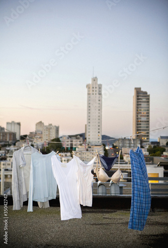 Laundry on clothes line on urban rooftop