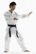 Asian male black belt practicing karate