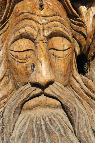 Face carved into an olive tree trunk in Matala