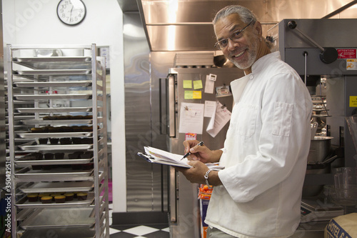 African American small business owner working in bakery kitchen