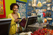 African American small business owner at cash register