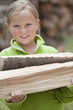 Caucasian girl carrying firewood