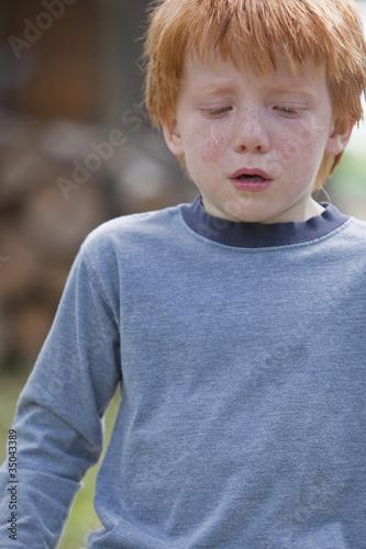 Caucasian boy crying