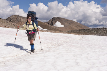 Hispanic woman hiking over snow