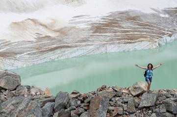 Hispanic woman hiking hear glacial lake