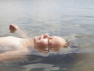 Caucasian boy floating in water