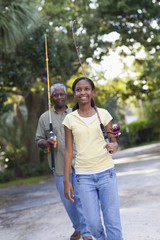 Black grandfather going fishing with granddaughter