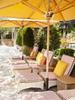 """Chaise lounge chairs under umbrellas at luxury resort in Napa Valley, California"""