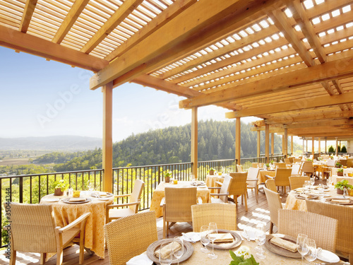 """Empty restaurant deck overlooking wine country at a luxury resort in Napa Valley, California"""