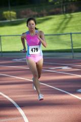Japanese relay runner running with baton