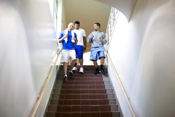 Friends walking downstairs together in sportswear