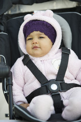 Mixed race baby in car seat