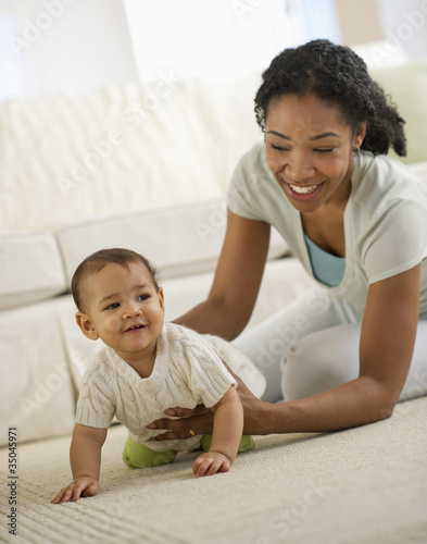 Mixed race mother playing with baby