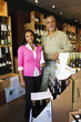 Small business owners working in wine shop