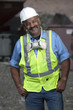 Hispanic sanitation worker in recycling plant