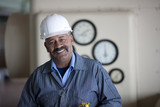 Smiling Hispanic worker in hard-hat