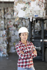 Hispanic sanitation worker working in recycling plant