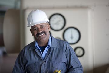 Smiling Hispanic worker in hard-hat