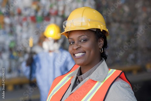 Black sanitation worker working in recycling plant