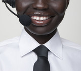 Smiling Black woman in call center headset