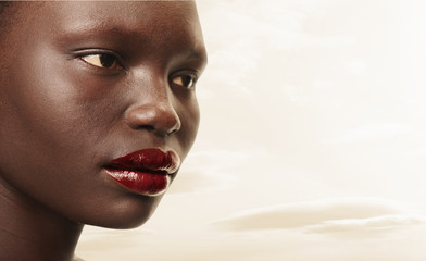Serious Black woman in red lipstick