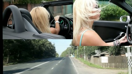 A glamour girl driving a cabriolet