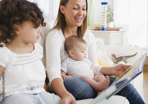 Mother reading daughters storybook