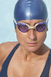 Wet Hispanic swimmer in goggles and swimming cap