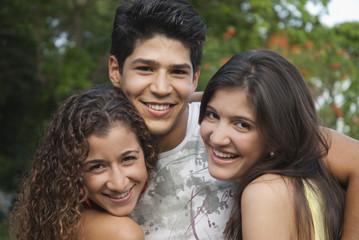 Hispanic friends hugging