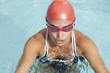 Hispanic swimmer in swimming pool