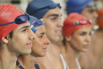 Hispanic swimmers standing in a row