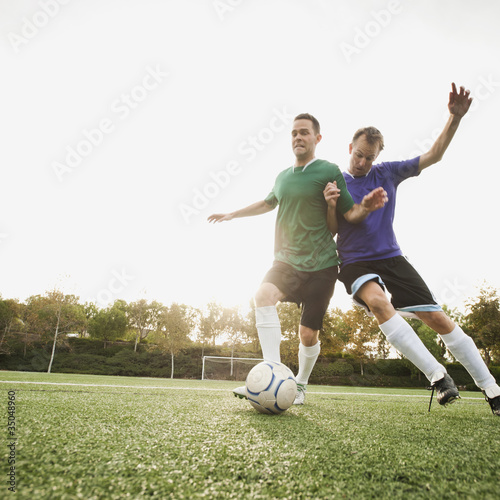 Men playing soccer on soccer field