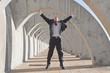 Hispanic businessman jumping in mid-air