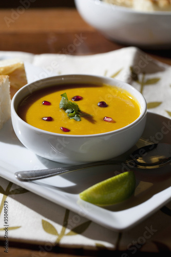 Curry soup in bowl with garnish